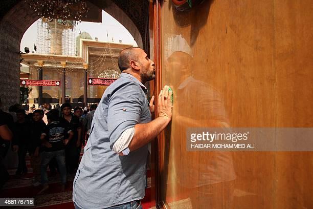 An Iraqi Shiite Muslim pilgrim arrives at Imam alKadhim shrine for rituals marking the death of Imam Mohammed alJawad the ninth Shiite imam in the...