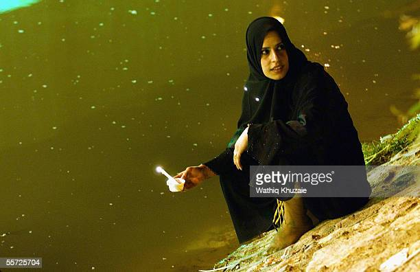 An Iraqi Shiite pilgrim lights candles September 19 2005 in the city of Karbala 70 miles south of Baghdad Iraq Hundreds of thousands of Iraqi Shiites...
