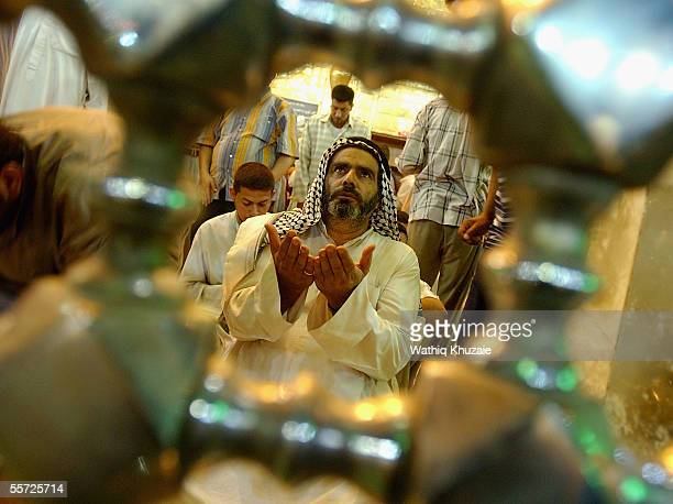 An Iraqi Shiite pilgrim prays September 19 2005 in the city of Karbala 70 miles south of Baghdad Iraq Hundreds of thousands of Iraqi Shiites gathered...