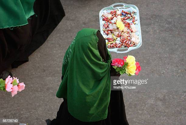 An Iraqi Shiite woman carries sweets September 19 2005 in the city of Karbala 70 miles south of Baghdad Iraq Hundreds of thousands of Iraqi Shiites...