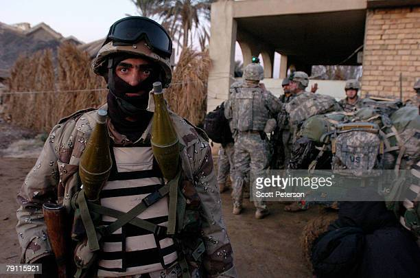 An Iraqi soldier and US Army soldiers of Troop A 2nd Squadron 1st Cavalry Regiment prepare to search for Al Qaeda militants in the Diyala River...