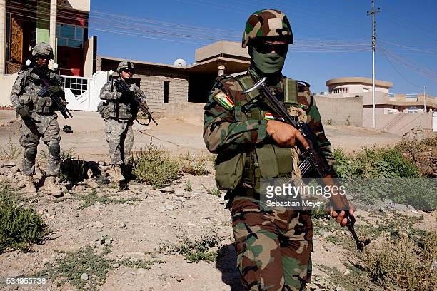 An Iraqi soldier from the Combined Security Forces out of Forward Operating Base Warrior conducts a patrol in Kirkuk with US soldiers The Combined...