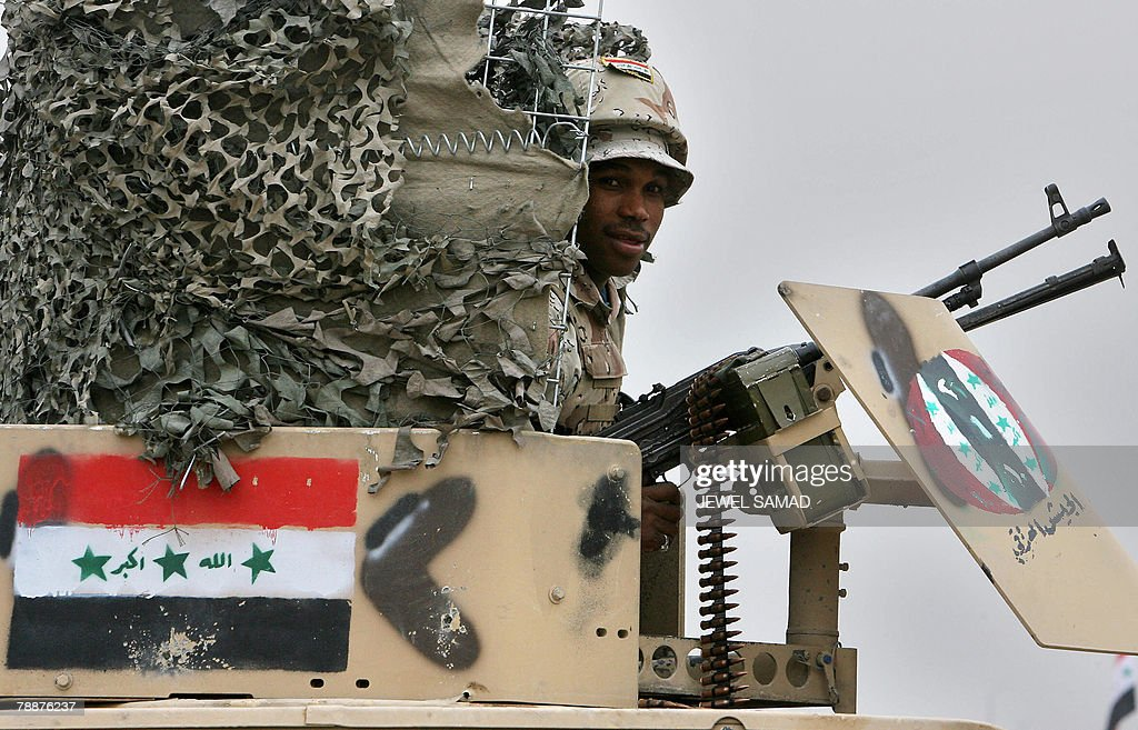 An Iraqi soldier mans his gun on top of : News Photo