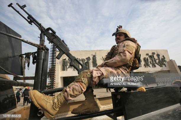 An Iraqi soldier sits atop a military vehicle in central Baghdad's Tahrir square during celebrations marking the founding of the Iraqi army on...