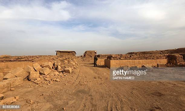 An Iraqi soldier stands amid destruction caused by the Islamic State group at the archaeological site of Nimrud some 30 kilometres south of Mosul in...