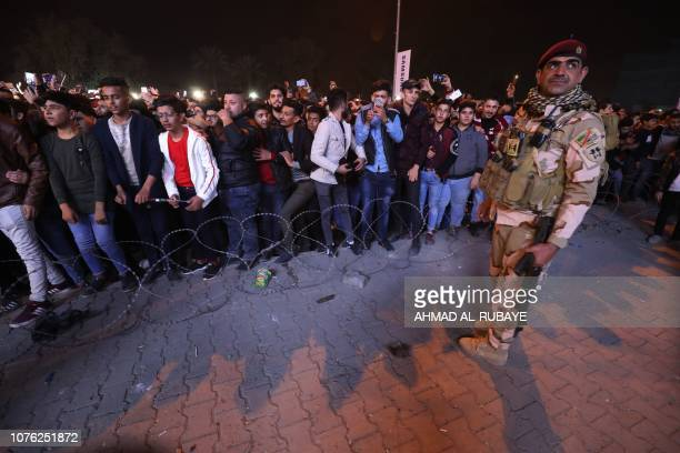 An Iraqi soldier stands guard as Iraqis celebrate the New Year January 1 2019 in Baghdad