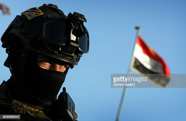 An Iraqi soldier stands guard at the entrance of the Nineveh base for liberation operations in Makhmur about 280 kilometres north of the capital...