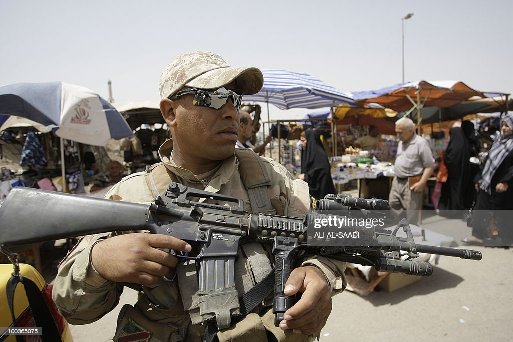 An Iraqi soldier stands guard during a patrol in one of Baghdad's popular markets on May 24, 2010. Iraqi security forces were sharply criticised on May 22, a day after a car bomb in a market in central Iraq killed 30 people, in the worst attack to hit the country since May 10.