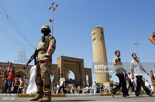 An Iraqi soldier stands guard in front of Abu Hanifa Sunni mosque September 9 2005 in Baghdad Iraq The United Nations said Sptember 8 that it refused...