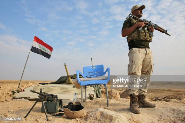 An Iraqi soldier stands guard near the Iraqi city of Qaim at the IraqiSyrian border on November 11 2018 Iraqi troops reinforced their positions along...