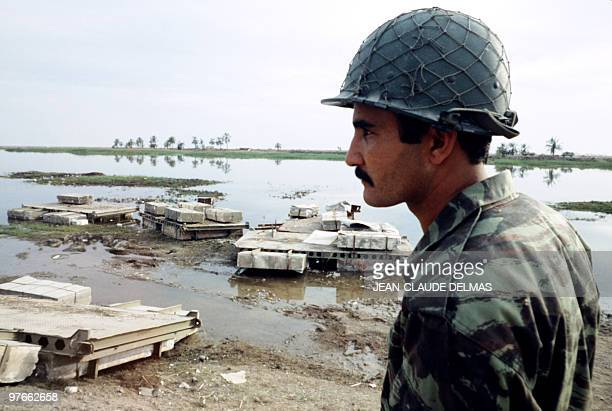 An Iraqi soldier stands in the swamp near the Iraqi city of alHoweizah north of Basra on March 20 1985 after a fierce battle opposed Iraqi and...