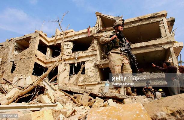 An Iraqi soldier stands on the rubble where two suicide car bombs exploded near Alhamra hotel on November 18 2005 Baghdad Iraq Two suicide bombers...