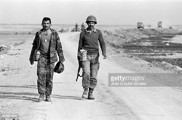 An Iraqi soldier walk after their victory of the battle in AlHoweizah swamps north of Basra on March 22 1985 The IraqIran war began in September 1980...