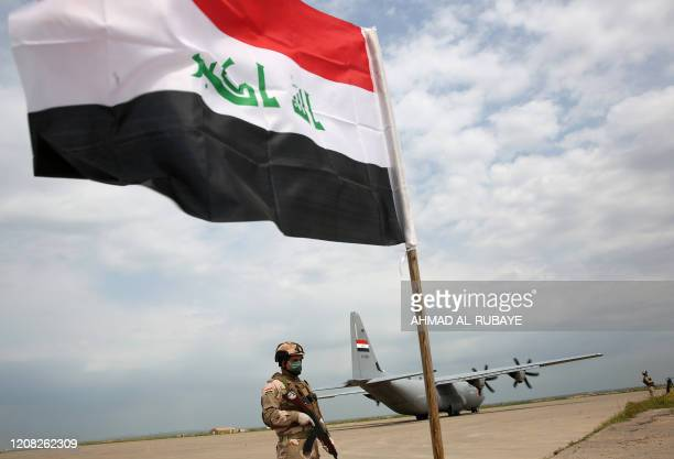 An Iraqi soldier walks at the Qayyarah air base, where US-led troops in 2017 had helped Iraqis plan out the fight against the Islamic State in nearby...
