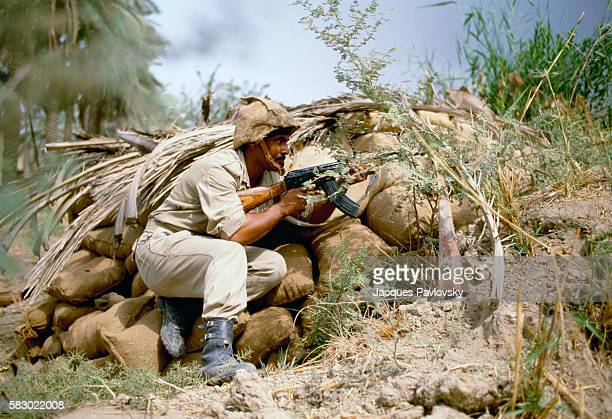 An Iraqi soldier with an assault rifle at the Khoramshar Front in Iran. War broke out between Iran and Iraq in 1980 and lasted until 1988 following...