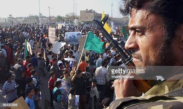 An Iraqi solider provides security as Iraqi Shiites take partin a demonstration supporting Grand Ayatollah Ali al-Sistani, just one day before the...