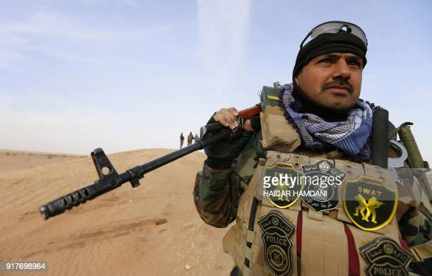 An Iraqi special forces member is seen as they conduct an operation targeting possible remaining Islamic State group jihadists in the Wadi Shabjah...