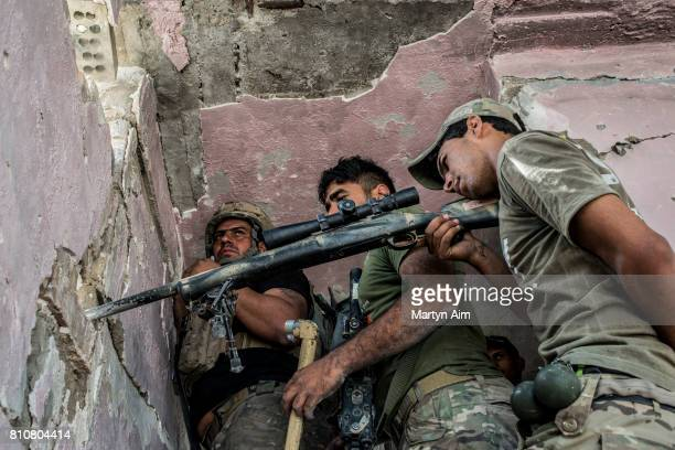 An Iraqi Special Operation Forces sniper team in the Islamic State occupied Old City district where heavy fighting continues on July 8 2017 in Mosul...