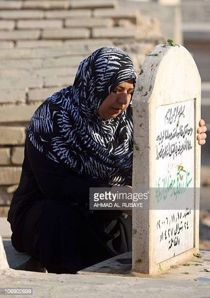 An Iraqi Sunni Muslim woman visits the graves of loved ones at the AlGhazali cemetery in Baghdad on November 16 2010 on the first day of Eid alAdha...