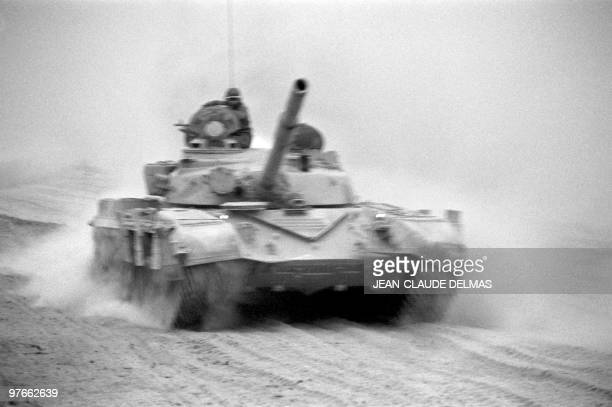 An Iraqi tank drives to the AlHoweizah swamps north of Basra on March 18 1985 The IraqIran war began in September 1980 after Iraqi troops and tanks...