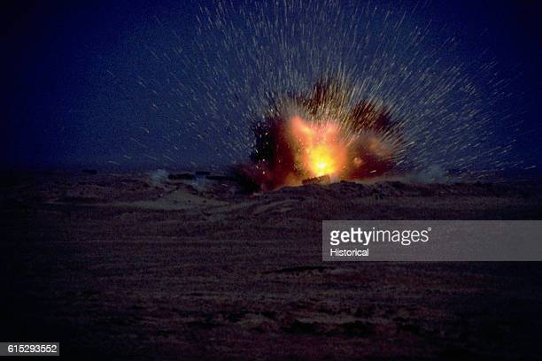 An Iraqi tank explodes after an attack by the 1st United Kingdom Armored Division during Operation Desert Storm