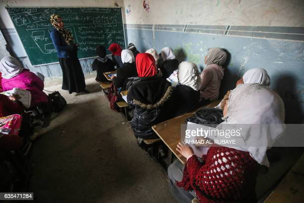 An Iraqi teacher gives a class to children they returned to a school in the village of Oreij south of Mosul after it was retaken from Islamic State...