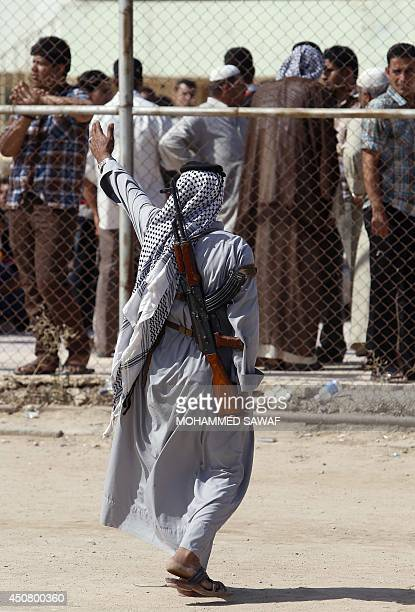 An Iraqi tribesman gestures as men loyal to Shiite cleric Moqtada alSadr gather to prepare to join Iraqi security forces in the fight against...