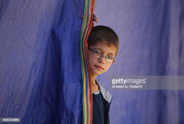 An Iraqi Turkman Shiite child displaced from the northern Iraqi area of Tal Afar takes shelter in a school in Sadr City, one of Baghdad's northern...