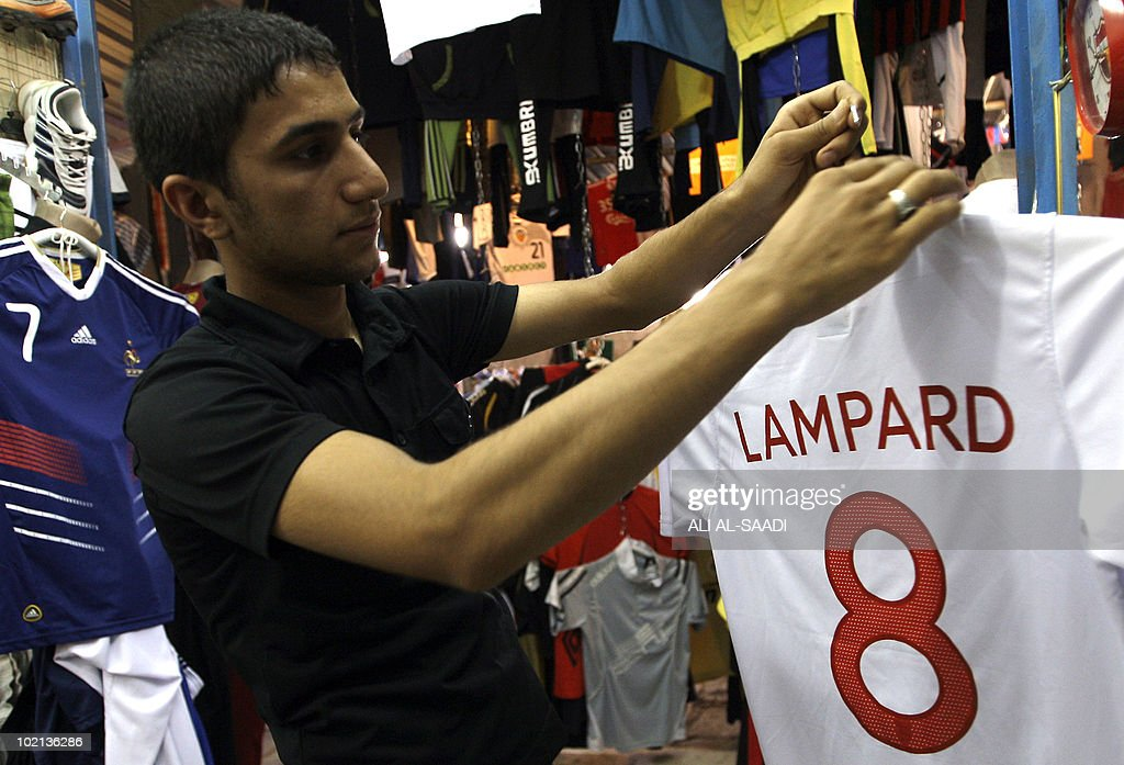 An Iraqi vendor hangs up a soccer shirt for England's Frank Lampard, as the war torn nation goes follows the World Cup 2010 taking place in South Africa, on June 16, 2010, in central Baghdad.