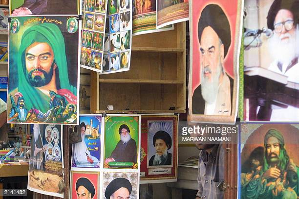 An Iraqi vendor sits in his store selling posters depicting different Shiite religious men from LR Imam Hussein the grandson of Islam's prophet...