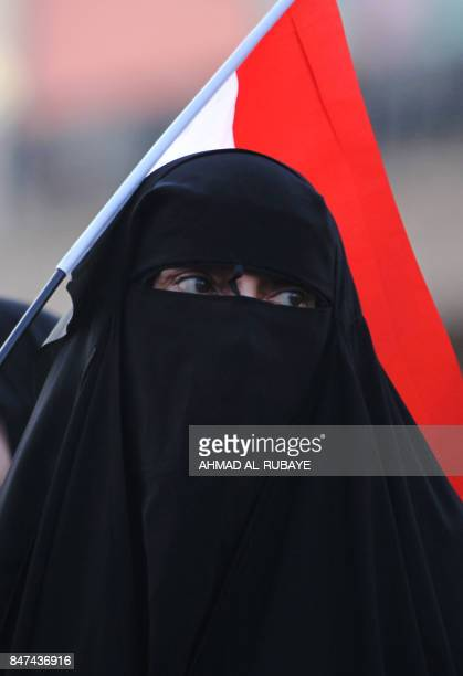 An Iraqi woman a follower of cleric Moqtada alSadr takes part in a demonstration against corruption in Iraq and demanding reform and a change in the...