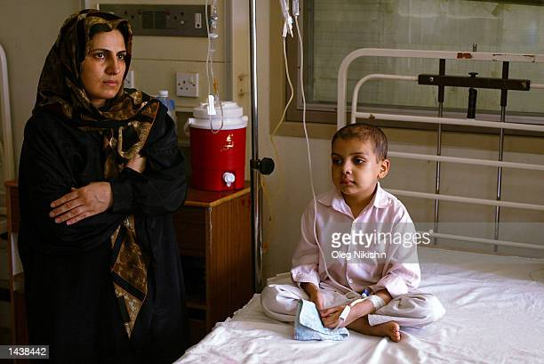An Iraqi woman and a child sit in the leukemia ward of the Al Mansoor Hospital where children with various forms of cancer attributed to the 1991 use...