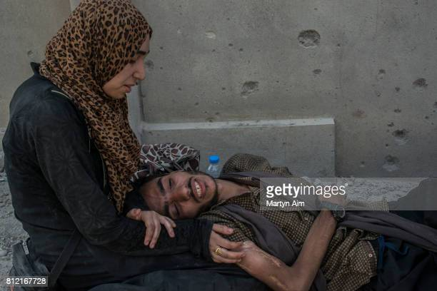 An Iraqi woman and her ill husband in the Islamic State occupied Old City district on July 10 2017 in Mosul Iraq The Iraqi government and armed...