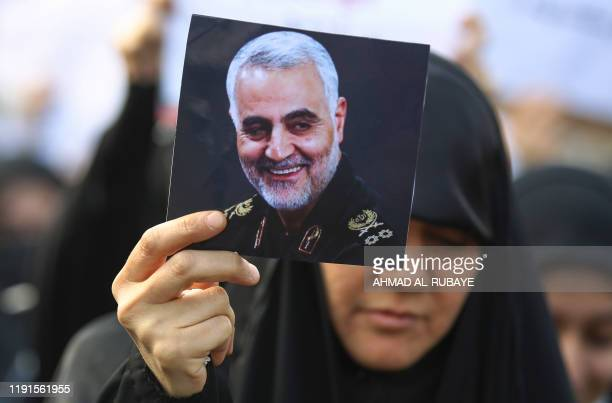 An Iraqi woman attends the funeral of Iranian military commander Qasem Soleimani Iraqi paramilitary chief Abu Mahdi alMuhandis and eight others in...