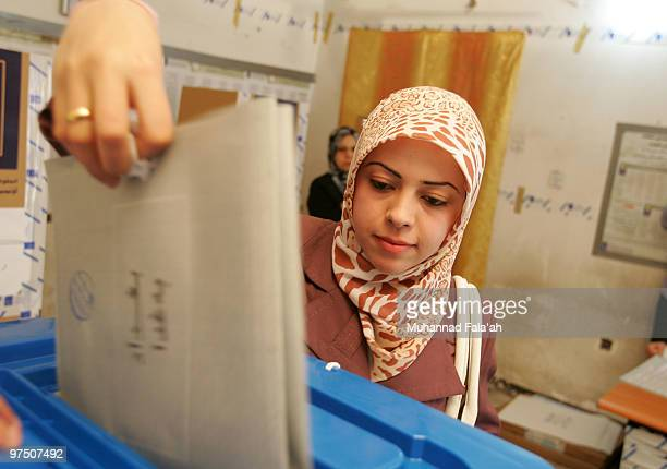 An Iraqi woman casts her ballot for the country's general elections at a polling station on March 7 2010 in Baghdad Iraq People in 18 Iraqi provinces...