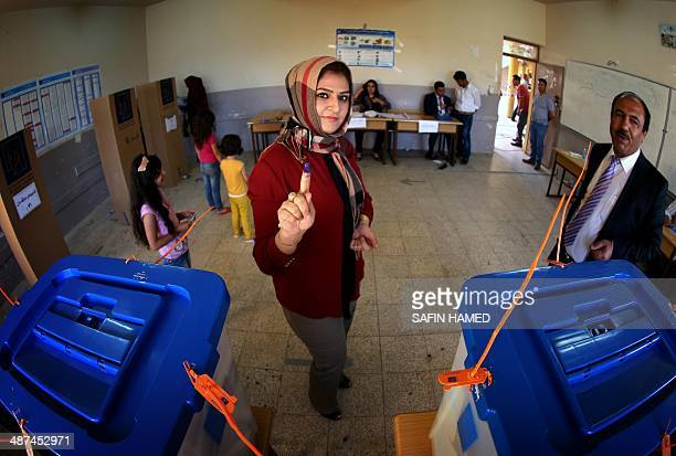 An Iraqi woman casts her vote in Iraq's first parliamentary election since US troops withdrew at a polling station in Arbil the capital of the...