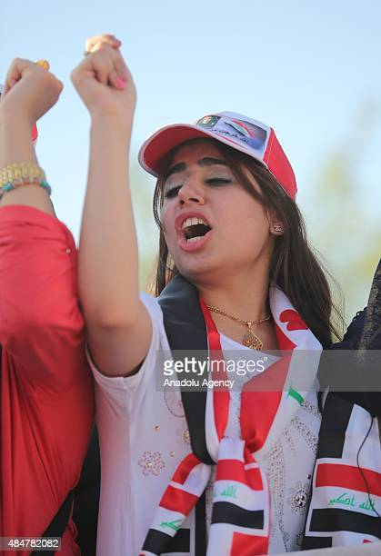An Iraqi woman demanding judicial reform and an end to corruption shouts slogans during a demonstration at Tahrir square in Baghdad Iraq on August 21...