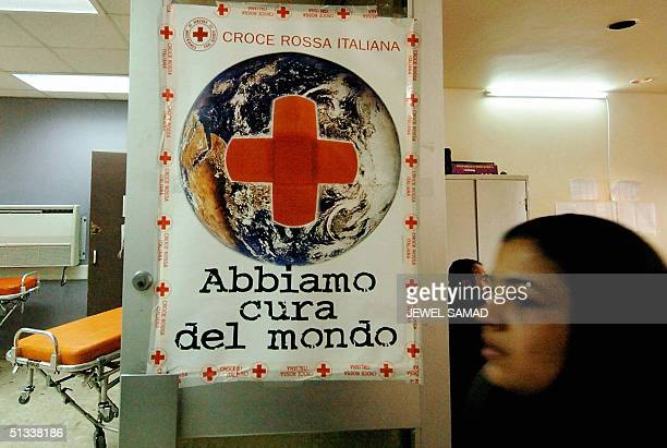 An Iraqi woman enters a makeshift hospital run by the Italian Red Cross in Baghdad, 23 September 2004. Despite security fears, several of medical...