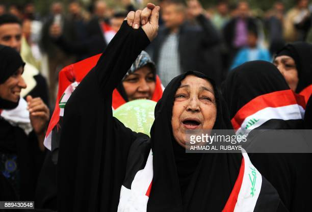 An Iraqi woman gestures in Baghdad's Tahrir Square on December 10 during a gathering celebrating the end of the three-year war against the Islamic...