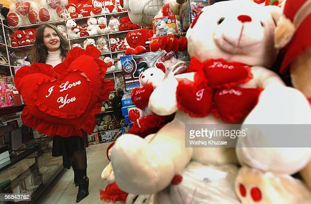 An Iraqi woman holds a Valentine's Day gift in a shop on February 14 2006 in Baghdad Iraq Despite the continuous violence Iraqis are celebrating St...