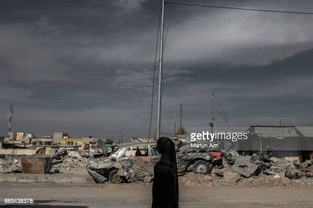 An Iraqi woman in the ruins of the liberated district of Al Jazaer in eastern Mosul recently recaptured from Islamic State control