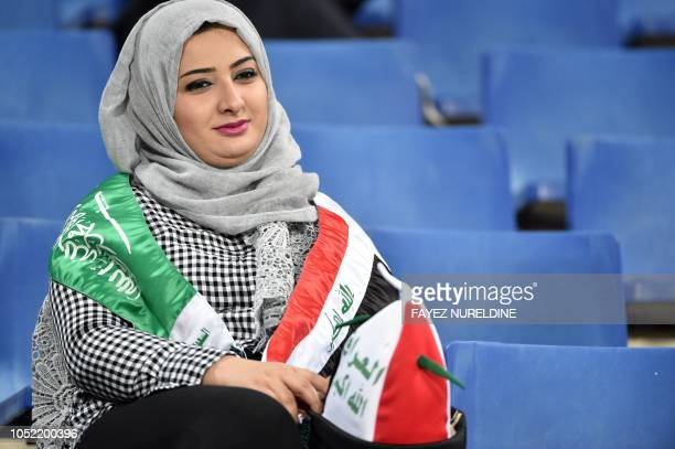 An Iraqi woman living in Riyadh watches a friendly football match between Saudi Arabia and Iraq for the Superclassico championship at King Saud...