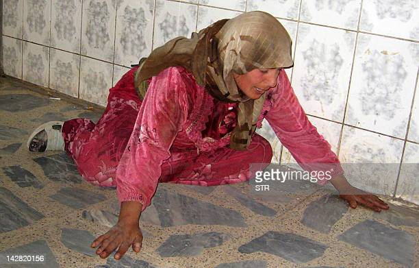 An Iraqi woman mourns the death of her relative at a hospital in the restive city of Baquba northeast of Baghdad 09 November 2007 A roadside bomb...
