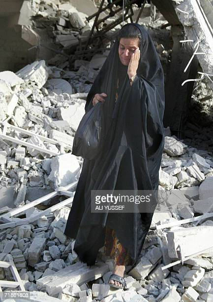 An Iraqi woman mourns the death of her relatives as she walks in the rubble of the Shiite mosque Husseiniya in the restive City of Baquba which was...
