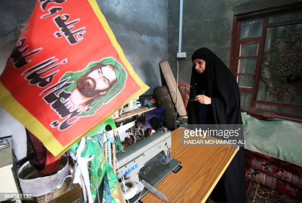 An Iraqi woman sews in a house in alZubair south of Basra on February 11 2018 Informal housing settlements are flourishing in the oilrich province of...