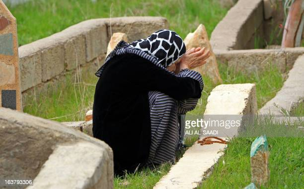 An Iraqi woman visits the grave of a relative who was killed during a gas attack by former Iraqi president Saddam Hussein in 1988 in the Kurdish town...