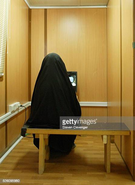 An Iraqi woman visits with a detainee relative by video US military allows visits between relatives and detainees by video when the distance is...