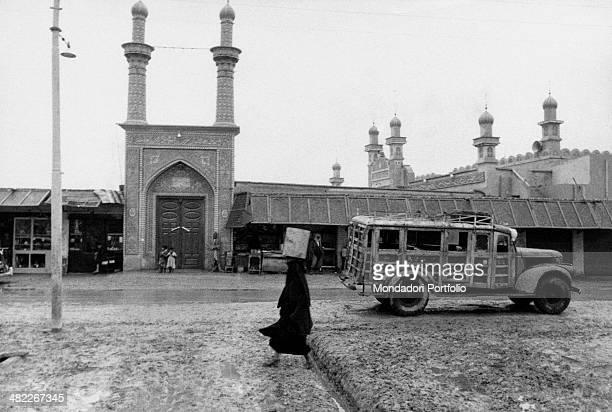 An Iraqi woman walking near the doorway of a mosque in the suburbs Bassora december 1956