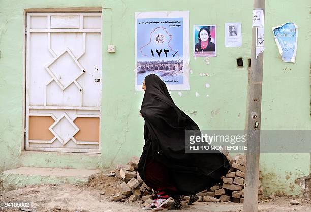 An Iraqi woman walks in the town of Khanaqin in Diyala province near Iraq's border with Iran on January 30 2009 AFP PHOTO/FILIPPO MONTEFORTE