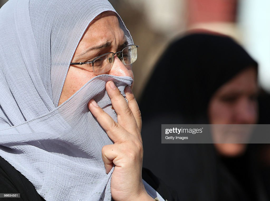 An Iraqi women cries near Mohsin al-Hakim Shiite mosque, which was the scene of a bombing on April 23, 2010 in Baghdad, Iraq. A series of bombings rocked a market and Shiite mosques as worshippers departed Friday Prayer services, killing at least 60 people and wounding many more.
